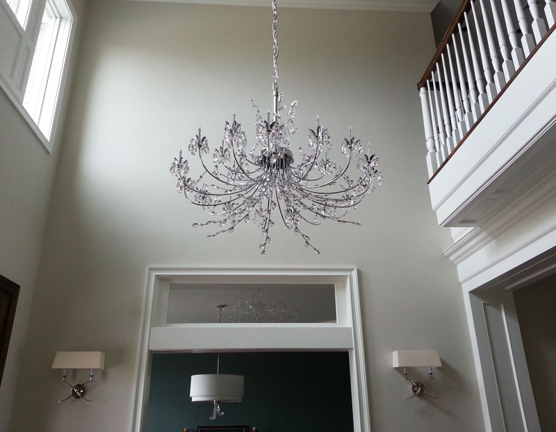 Dining room  LED cove lighting, Led recessed lights and a chandelier all controlled with a touch of a button.
