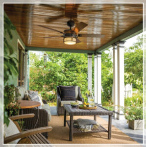 porch with outdoor fan and furniture